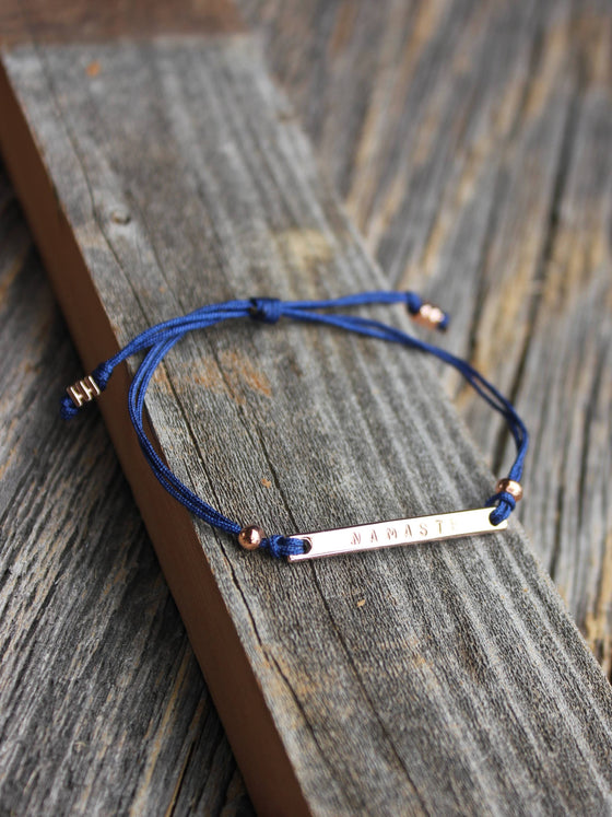 Dainty rose gold personalized bracelet with navy blue nylon cord