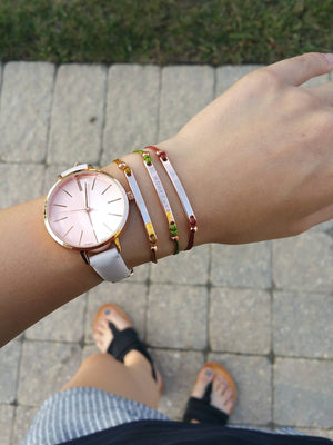 Model wearing dainty rose gold personalized bracelets with nylon cords