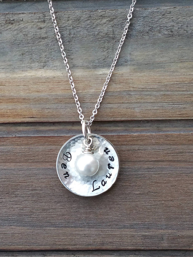 Personalized silver domed circle pendant with a pearl charm necklace