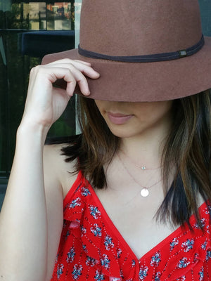 Model wearing a dainty rose gold personalized layered disc with mint glass charm necklace