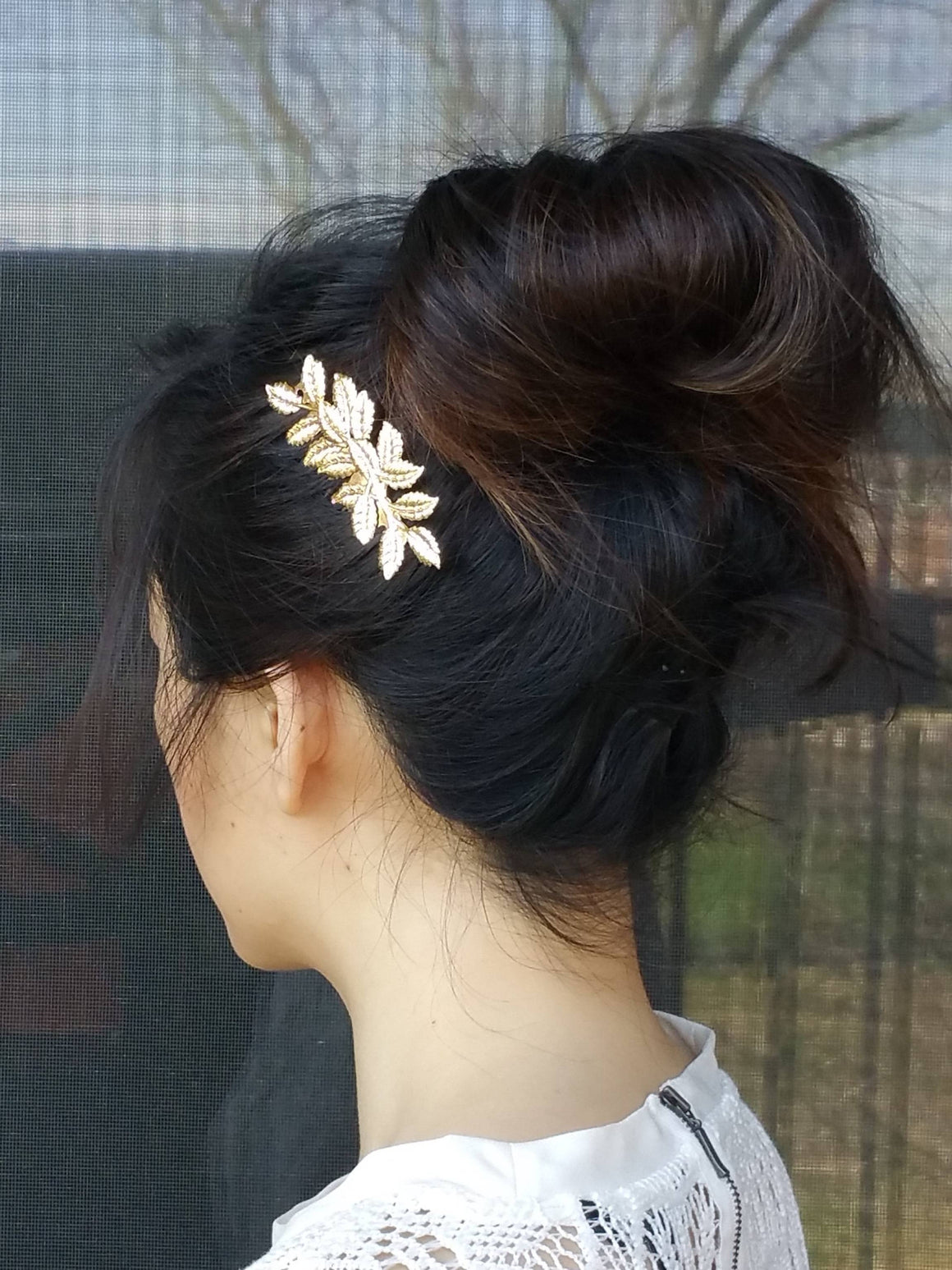 Woman wearing a laurel leaf hair comb for a wedding