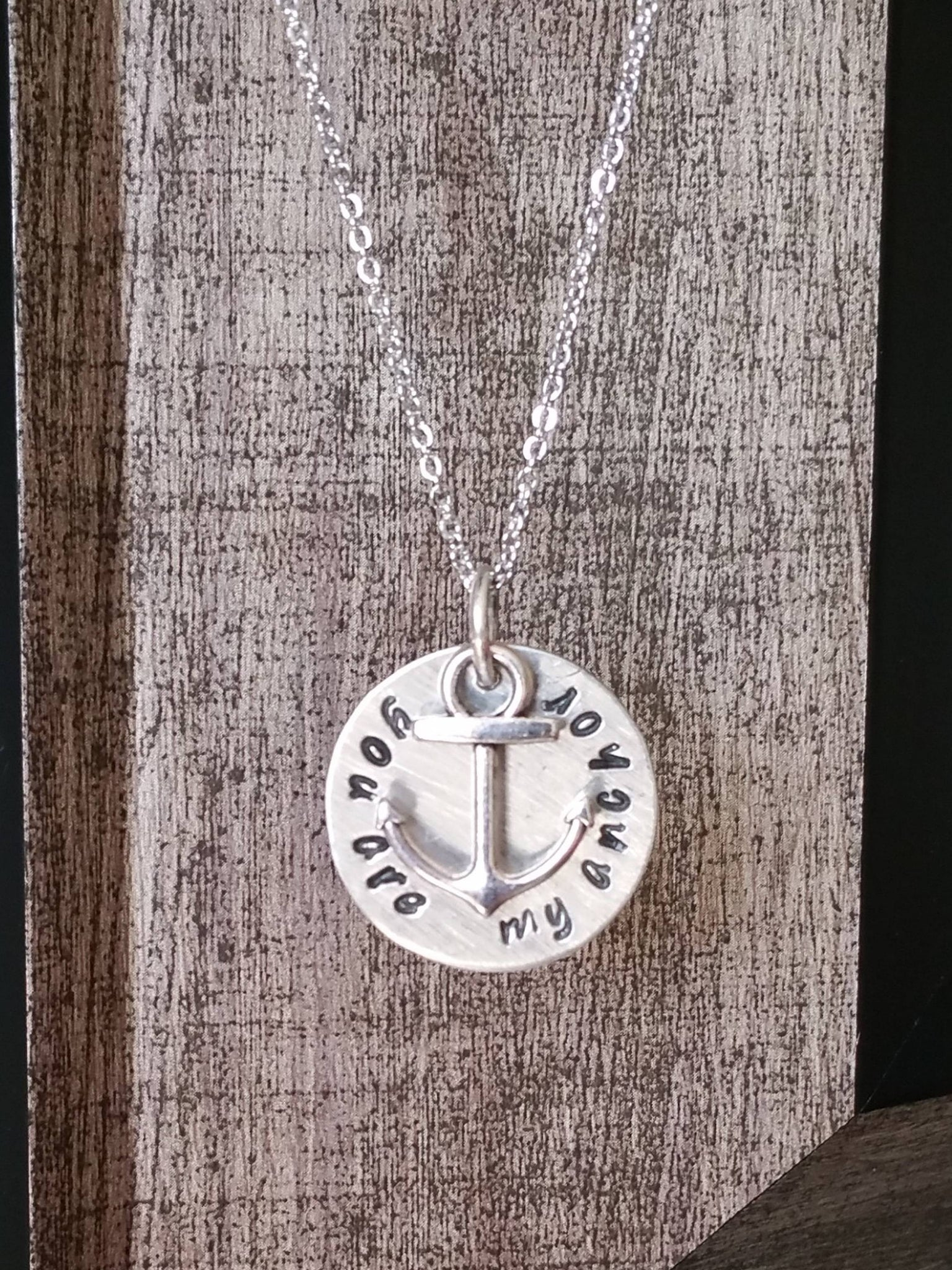 Personalized circle pendant with an anchor charm necklace