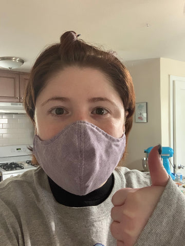 Woman Wearing A Mask Giving A Thumbs Up.