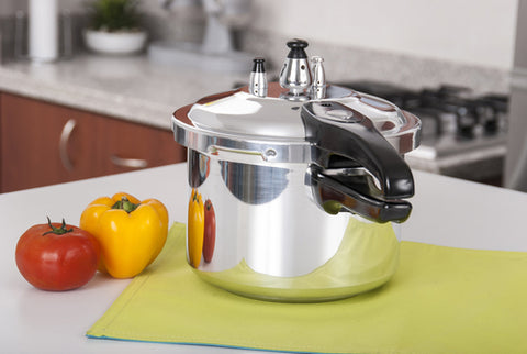 double handle pressure cooker with vegetables