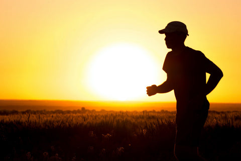 running at sunset with hat