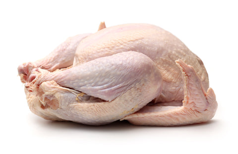 raw uncooked turkey with white background