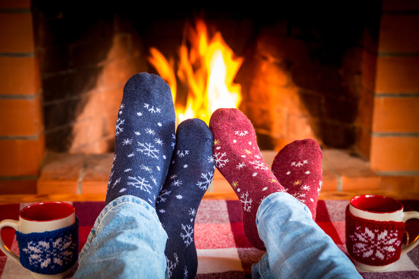 holidays-relax socks by fire couple