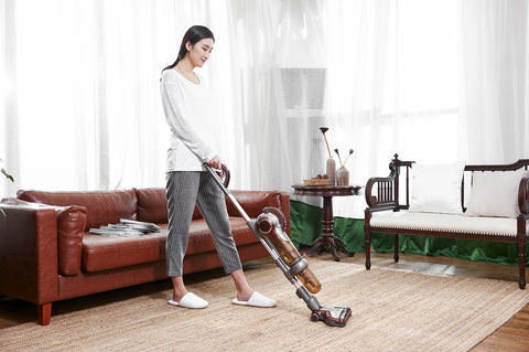 Woman With Upright Vacuum