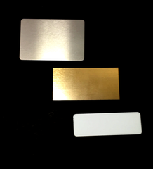 Silver Gold and White Aluminum Badges