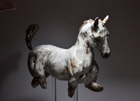 trotting ceramic horse sculpture by Susie Benes