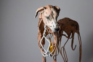 Wire and clay whippet dog sculpture with gold heart by Susie Benes