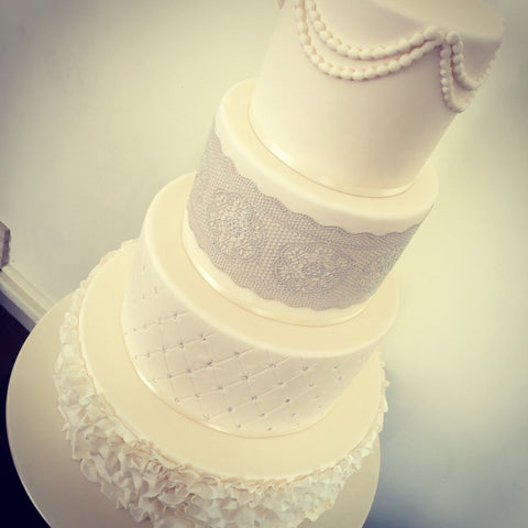 Four Tier White Lace Wedding Cake