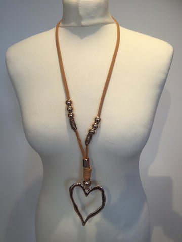 Long tan leather necklace with rose gold beads and large heart