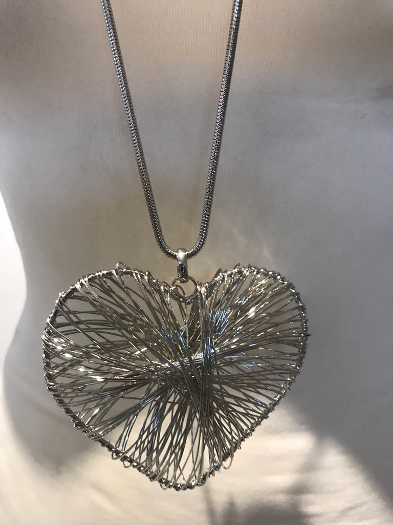 Long silver abstract heart necklace wire design – The secret ...