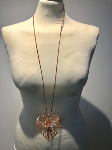 Long abstract heart necklace rose gold in colour