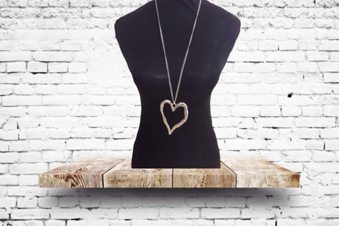 Long silver necklace with large heart pendant