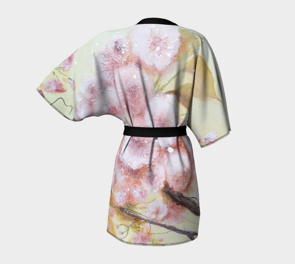 kimono style robe with pink flowers on warm background - view from the back