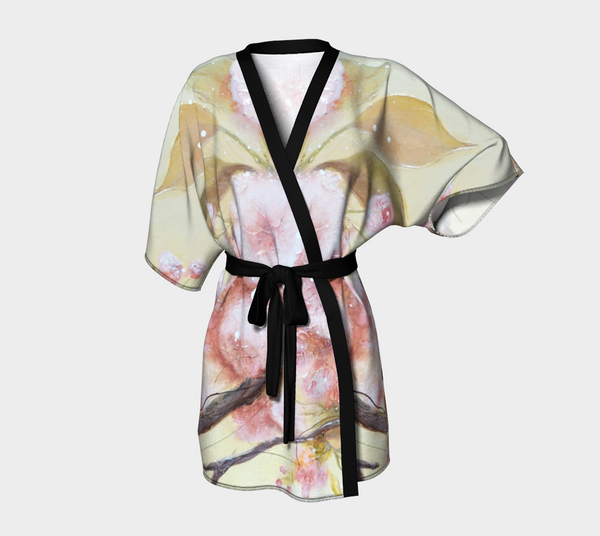 kimono style robe with pink flowers on warm background