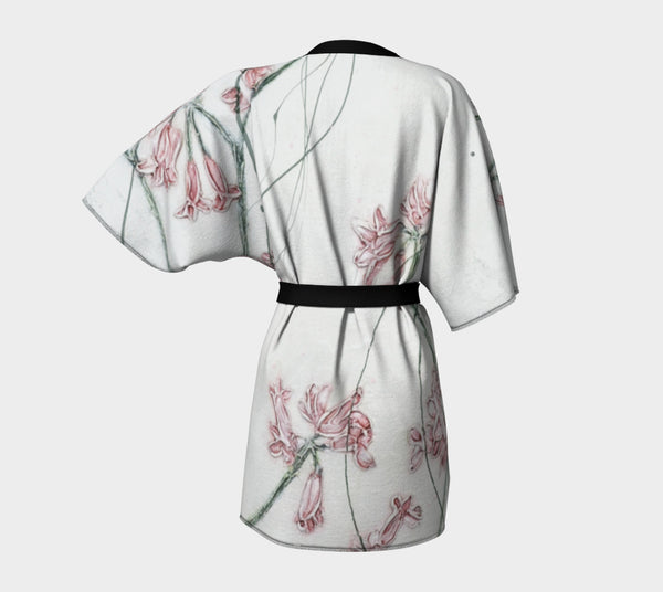 kimono style robe with pink flowers on white background - viewed from the back