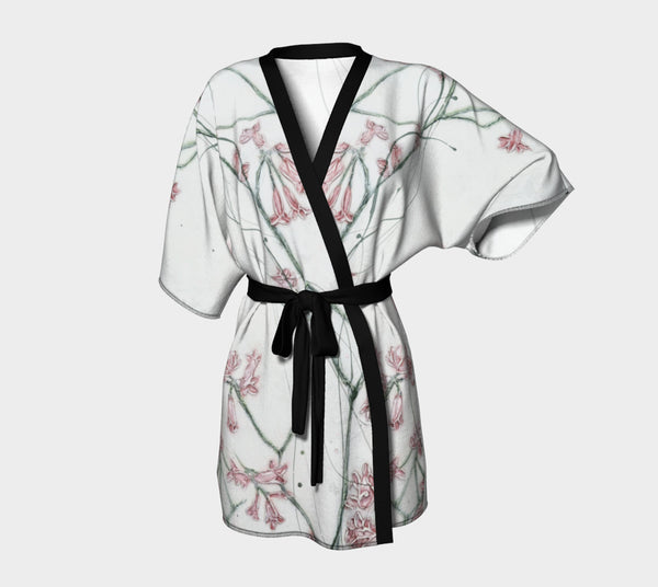 kimono style robe with pink flowers on white background