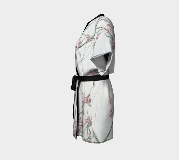 kimono style robe with pink flowers on white background - side view
