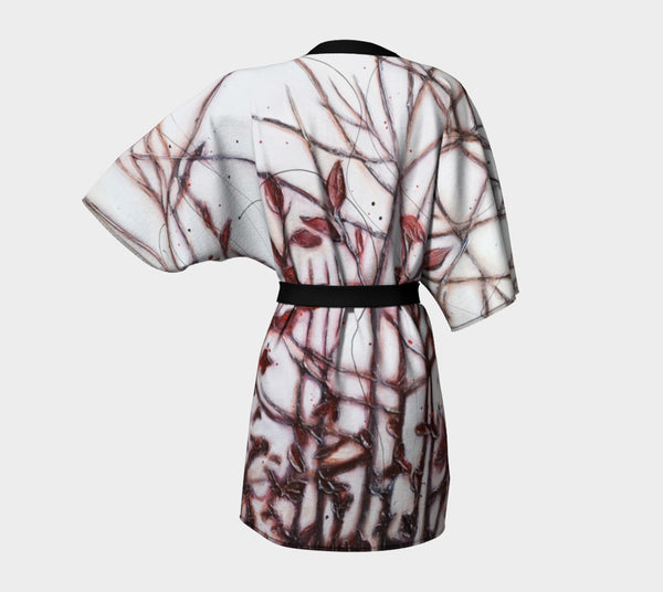 kimono style robe with deep red leaves and branches on white background - view from the back