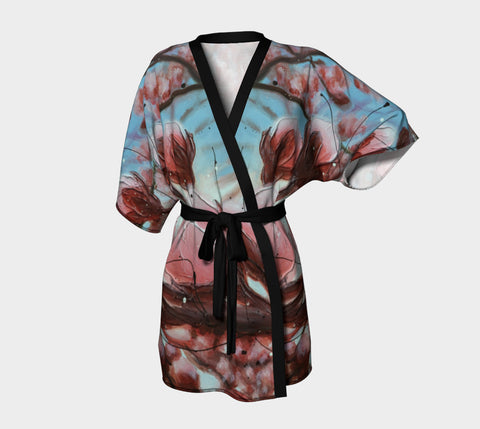kimono style robe with deep pink flowers on a blue background