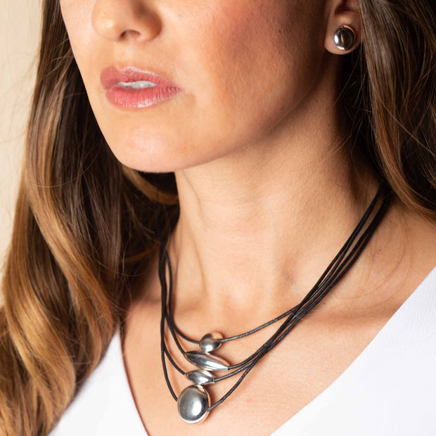 Leather necklace with geometric silver figures