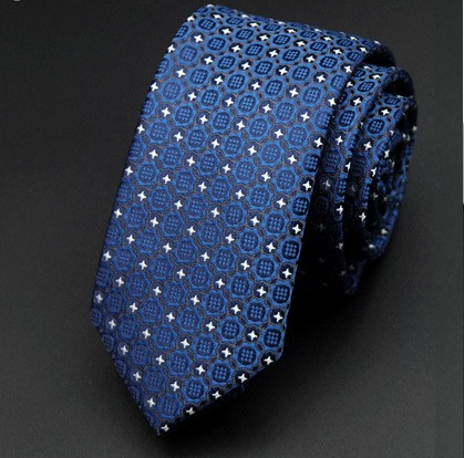 blue skinny tie with geometric white and gray designs the