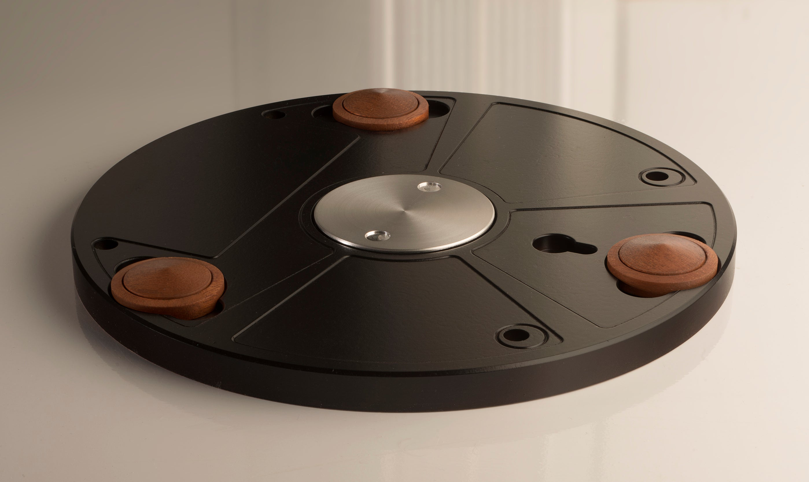 An early production sample of Wheel's Pertinax base with its levitating wooden feet.