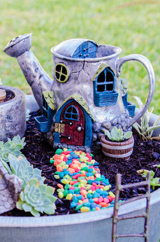 Fiddlehead Watering Can Home