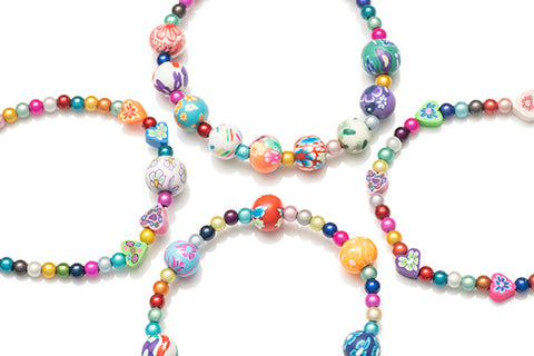 Beautiful Fimo Hearts and Flower beads included in this kit
