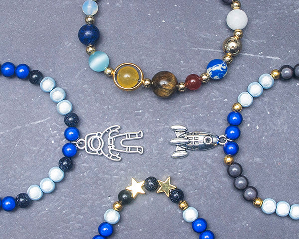 Star bracelet with planets and feature charms