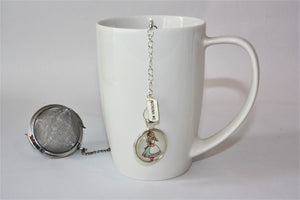 Alice's Tea Ball and white mug