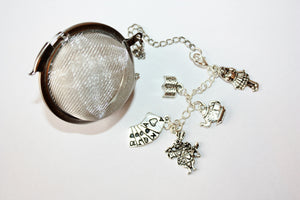 Alice's Tea teaball with charms