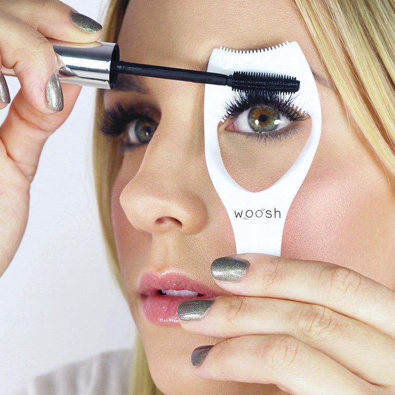 mascara shield in use with mascara protecting upper lid and lengthening lashes on model