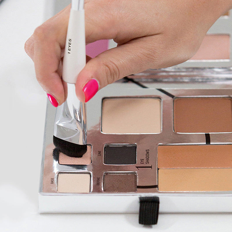 Fold Out Face palette opened. Model is using the eye brush from the essential brush set in shine eyeshadow color.