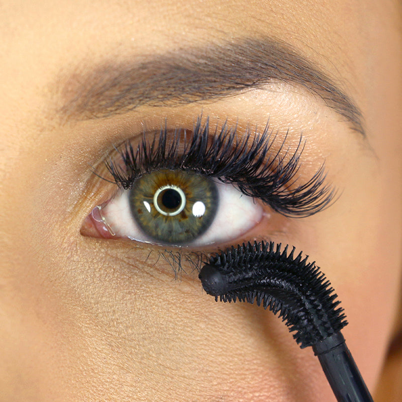 flex and curl mascara application wand bent using on lower lashes by model