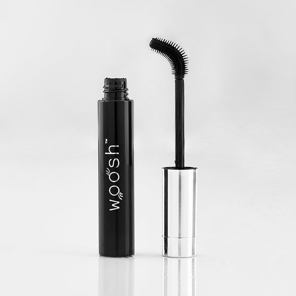 flex and curl mascara out of tube showing that the wand can twist and bend