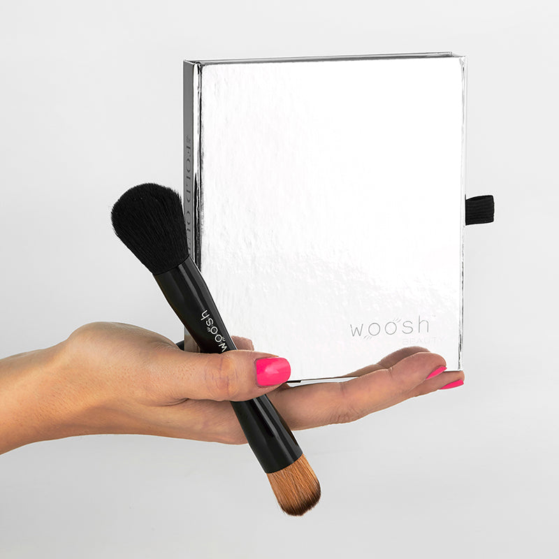Fold Out Face palette closed with 4 piece secret brush set in hand.