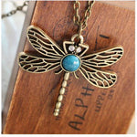 A beautiful Dragonfly with a faux Turquoise Body hangs on a Long Sweater Chain