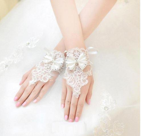 Gorgeous Short Fingerless Bridal Gloves - Made of Lace, Crystals and Embellished with a Bow