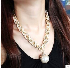 Amazing Sweater Chain of Gold Tone & Pearl, finished with a large dangle Pearl.
