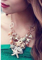 Seashells and Starfish making a Statement in a Big Bib Choker - Gold Plated with Faux Pearls