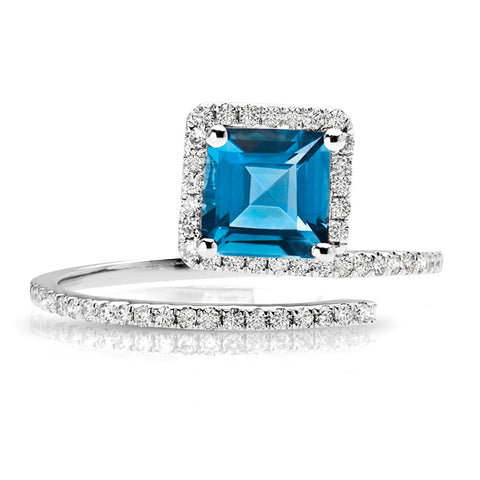 S1DR169 - 14K LIGHT BLUE TOPAZ & DIAMOND RING