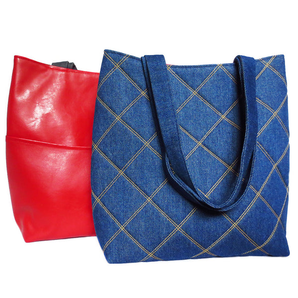 the anjelica 517 tote from Holland Cox with a bright red vinyl back