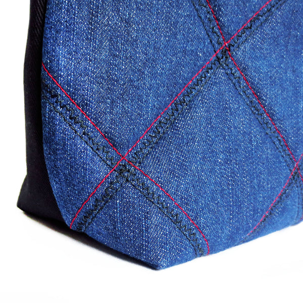 detail of the check motif stitched into the ellington 517 tote