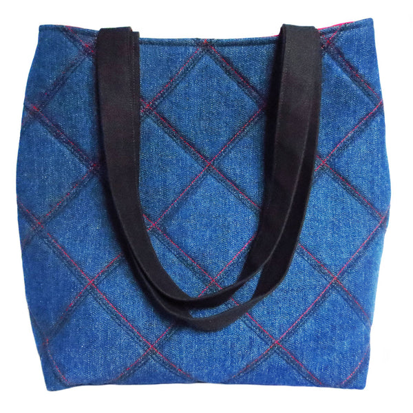 the 517 tote from Holland Cox in dark blue denim with stitched details