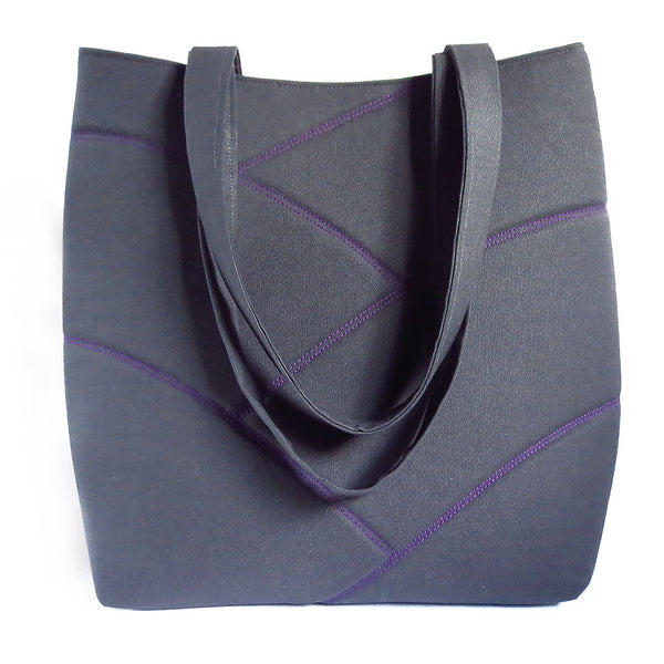 Dark gray and purple vegan tote bag, perfect for hauling books and papers to school or work in style. Purple stitching on gray, with bright purple back.