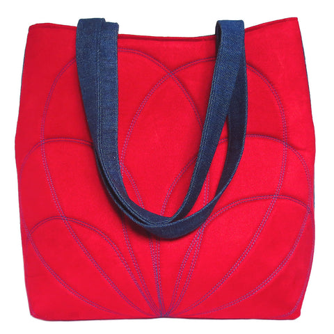 abstract petal motif stitched into red ultrasuede